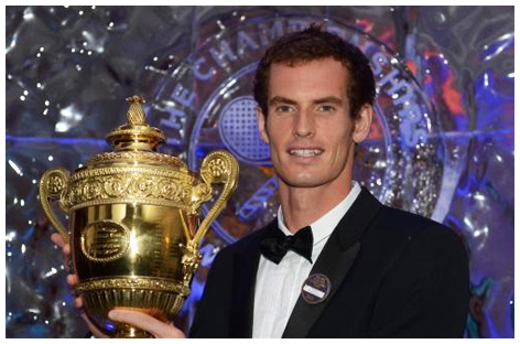 Andy Murray holding his BBC Sports Personality of The Year trophy