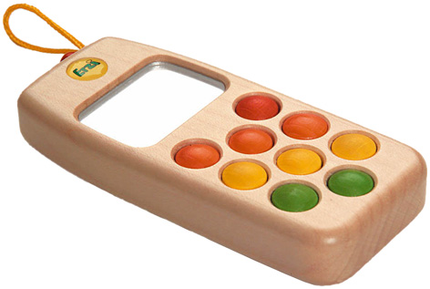 A wooden toy mobile phone from Erzi
