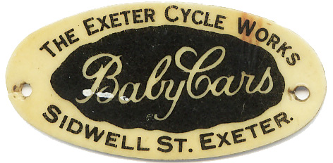 A plastic label that used to be attached to those baby carriages sold at Exeter Cycle Works
