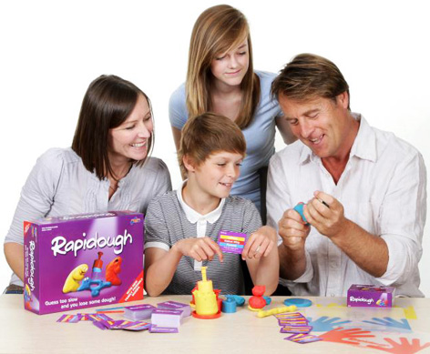 Family playing with their New Family Rapidough Game