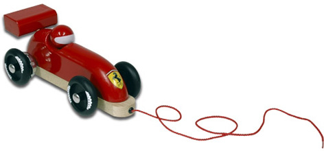 A pull-along wooden toy Ferrari