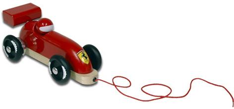 A pull-along wooden toy Ferrari
