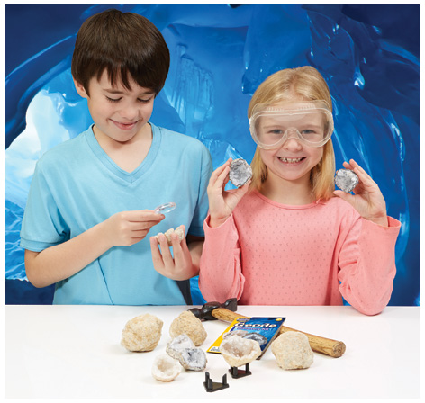 Boy and girl playing with their Geode Discovery Kit