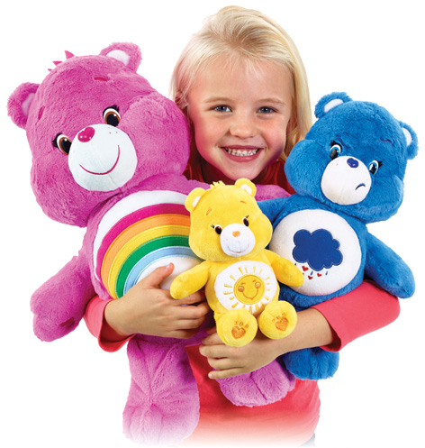 Girl with her favourite Care Bears