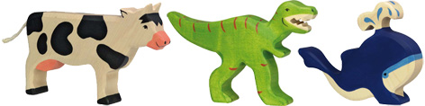 A selection of Holztiger toys - Cow, dinosaur and whale wooden toy figures