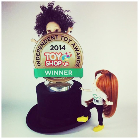 Makie dolls playing with their winners' trophy