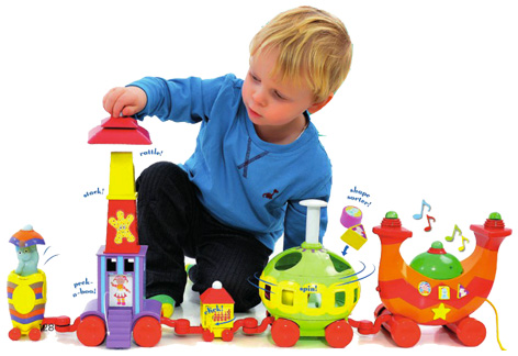 Boy playing with his Ninky Nonk Train and Track Set
