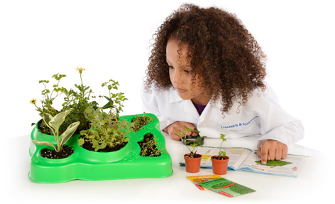 Girl playing with her Little Labs Botany Kit