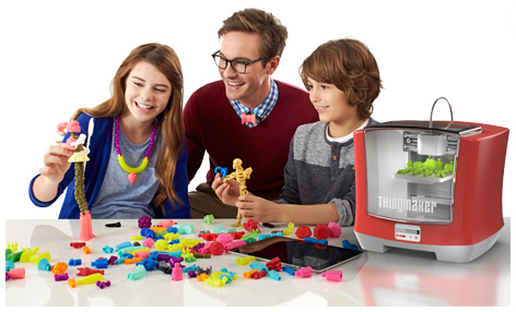 Family playing with Mattel's 3D ThingMaker Printer