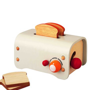 An eco-friendly wooden toy toaster from Plan Toys
