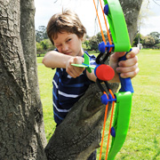 Boy taking aim with his Z-Curve Launcher from Wind Designs